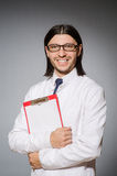 The male doctor with diary against gray Royalty Free Stock Images
