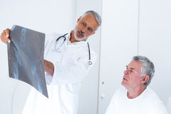 Male doctor discussing x-ray with senior man Stock Photography