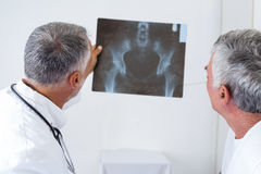 Male doctor discussing x-ray with senior man Stock Images