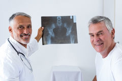 Male doctor discussing x-ray with senior man Royalty Free Stock Photo