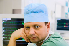 Male doctor with ecg monitor Royalty Free Stock Photos