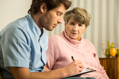 Male doctor and elder woman Royalty Free Stock Images