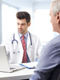 Male doctor with elderly patient Stock Images