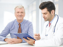 Male doctor with elderly patient Royalty Free Stock Image