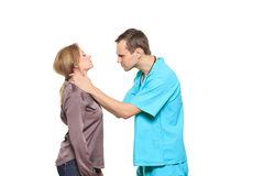 Male doctor examines a female patient. isolated on Royalty Free Stock Photos