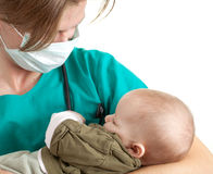 Male doctor examining baby boy Stock Photography