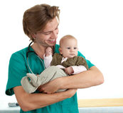 Male doctor examining baby boy Stock Photo