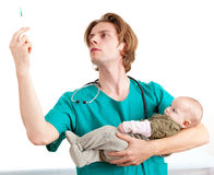 Male doctor examining baby boy Stock Photos