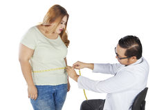 Male doctor examining his patient Stock Image