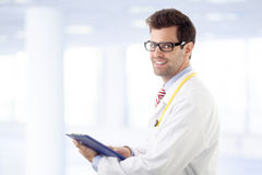 Male doctor examining medical report Stock Photography