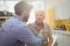 Male doctor examining a patient. At the hospital Royalty Free Stock Photos