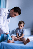 Male doctor examining patient Stock Images