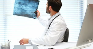 Male doctor examining x-ray stock video footage