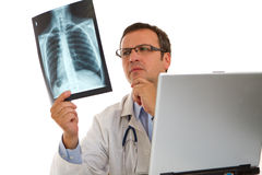 Male doctor examining an x-ray image Stock Photos