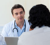 Male doctor explaining diagnosis Royalty Free Stock Images