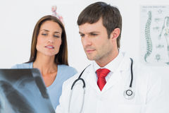 Male doctor explaining lungs xray to female patient. In the medical office royalty free stock images