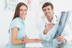 Male doctor explaining spine xray to female patient Royalty Free Stock Photos