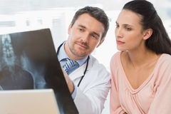 Male doctor explaining xray report to patient Royalty Free Stock Photos