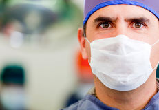Male doctor with facemask Stock Images