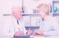 Male doctor with female client Royalty Free Stock Image