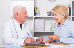 Male doctor with female client Stock Images
