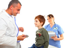 Male Doctor and Female nurse examining a boy Royalty Free Stock Photo