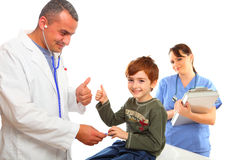 Male Doctor and Female nurse examining a boy Stock Photo
