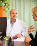 Male doctor with female patient Stock Images