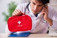 The male doctor with first aid bag royalty free stock photography
