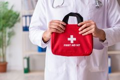 The male doctor with first aid bag royalty free stock photos