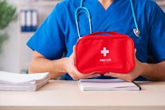 The male doctor with first aid bag stock photos
