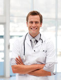 Male Doctor with Folded arms looking at camera royalty free stock photos