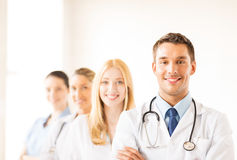 Male doctor in front of medical group Stock Photo