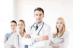 Male doctor in front of medical group Stock Photography