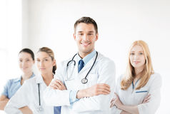 Male doctor in front of medical group Stock Image