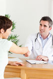 Male Doctor greeting a patient Stock Photo