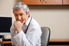 Male Doctor With Hand On Chin Royalty Free Stock Photos
