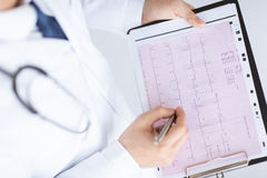 Male doctor hands with cardiogram Stock Photography