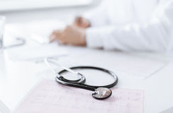 Male doctor hands with cardiogram Royalty Free Stock Image