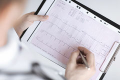 Male doctor hands with cardiogram Stock Photo