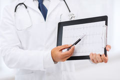 Male doctor hands holding cardiogram. Healthcare and medical concept - male doctor hands holding cardiogram Stock Photo