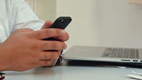 Male doctor hands using mobile phone stock video