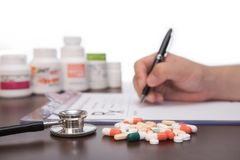 Male doctor hands writing rx prescription.  Stock Photo