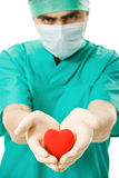 Male doctor with a heart in his hands Royalty Free Stock Photo