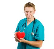 Male doctor with a heart in his hands Royalty Free Stock Photography