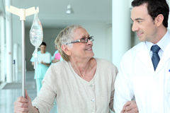 Male doctor helping patient royalty free stock images