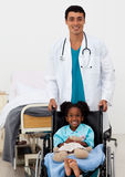 Male Doctor helping a sick child Stock Photos