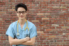 Male doctor with his arms crossed.  Royalty Free Stock Image