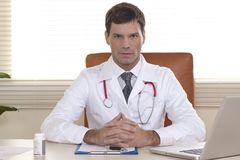 Male Doctor in his office Royalty Free Stock Image