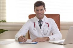 Male Doctor in his office Royalty Free Stock Images